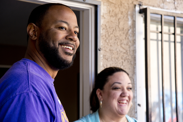 New Genesis Transitional Housing executive director Maurice Page, and Tania Fernandez watch during a volunteer event held by the Gaels Give Hope organization from Bishop Gorman High School, benefi ...