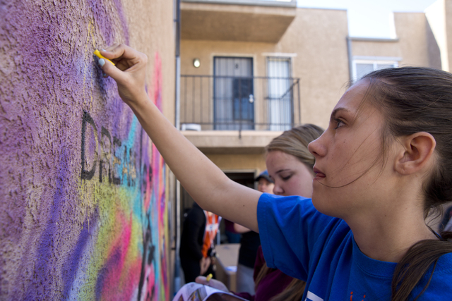 Olivia McEvoy works on mural during a volunteer event held by the Gaels Give Hope organization from Bishop Gorman High School, benefitting a New Genesis Transitional Housing apartment complex in L ...