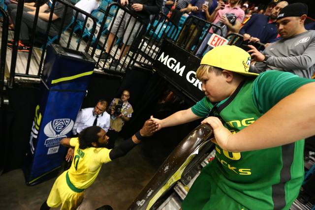 Oregon Ducks forward Dwayne Benjamin (0) exits the arena after defeating the Arizona Wildcats in the Pac-12 Conference basketball tournament semifinals at the MGM Grand Garden Arena in Las Vegas o ...