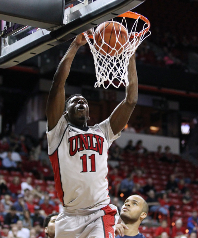 UNLV forward Goodluck Okonoboh dunks on UNR during the first half of their Mountain West Conference tournament game Wednesday, March 11, 2015, at the Thomas & Mack Center. (Sam Morris/Las Vega ...