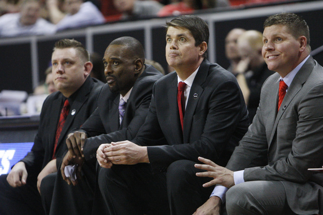 Former UNLV coaches, from left, Todd Simon, Stacey Augmon, Dave Rice and Ryan Miller watch their Mountain West tournament game against UNR on Wednesday, March 11, 2015, at the Thomas & Mack Ce ...
