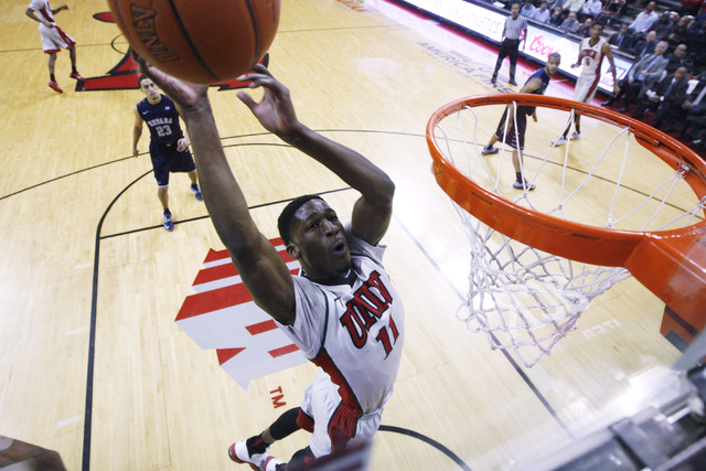 UNLV forward Goodluck Okonoboh drives in for a basket against UNR during their Mountain West Conference basketball game Wednesday, Jan. 7, 2015, at the Thomas & Mack Center. UNR won the game 6 ...