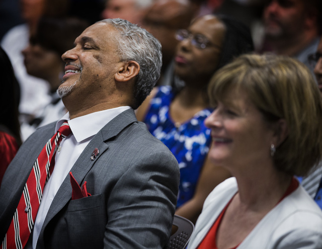 New UNLV men's basketball coach Marvin Menzies,left, and Tina Murphy-Kunzel smile after the University of Nevada Board of Regents approved his contract on Friday, April 22, 2016. Jeff Scheid/Las V ...