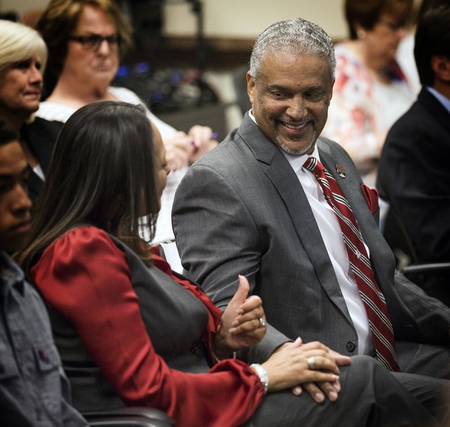New UNLV men's basketball coach Marvin Menzies,right, gets a thumps up from his wife Tammy  after the University of Nevada Board of Regents approved his contract on Friday, April 22, 2016. Jeff Sc ...