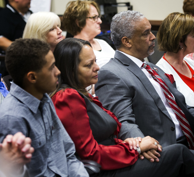 New UNLV men's basketball coach Marvin Menzies,right, and his wife Tammy holds hands while the University of Nevada Board of Regents approved his contract on Friday, April 22, 2016. Jeff Scheid/La ...