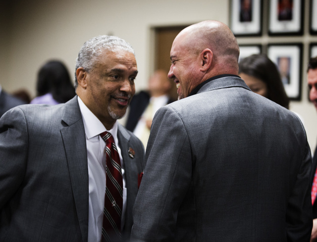 New UNLV men's basketball coach Marvin Menzies and UNLV football coach talk before the University of Nevada Board of Regents approved his contract on Friday, April 22, 2016. Jeff Scheid/Las Vegas  ...