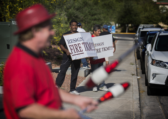 Protestors demonstrate in from University of Nevada Board of Regents building, Friday, April 22, 2016, before a hearing to approve new UNLV men's basketball coach Marvin Menzies contract. Jeff Sch ...