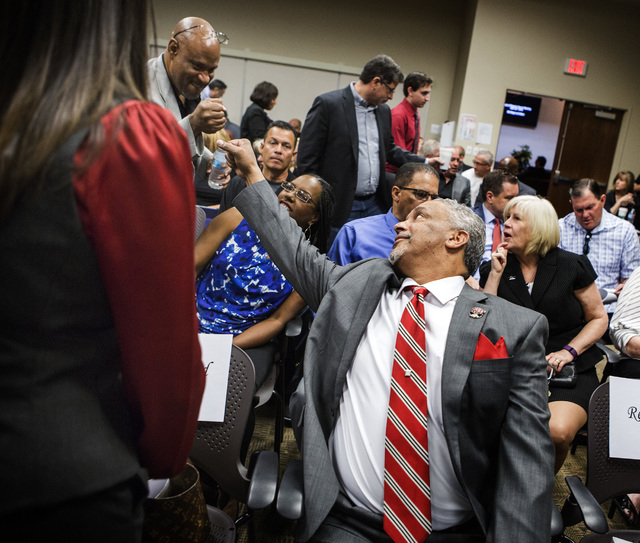 New UNLV men's basketball coach Marvin Menzies fists a supporter before the University of Nevada Board Regents approved his contract on Friday, April 22, 2016. Jeff Scheid/Las Vegas Review-Journal ...