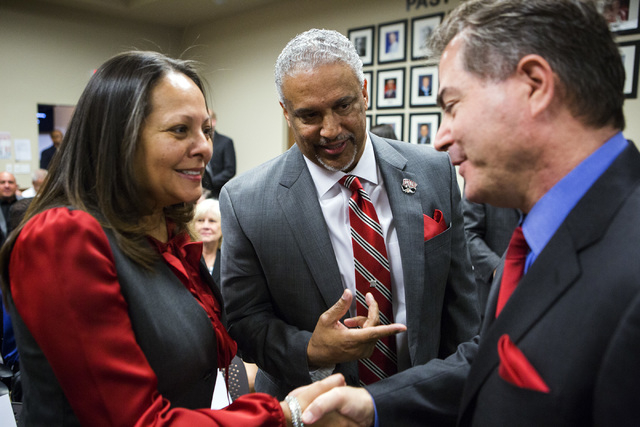 New UNLV men's basketball coach Marvin Menzies, center, introduces his wife Tammy to UNLV president Len Jessup before the University of Nevada Board of Regents approved his contract on Friday, Apr ...