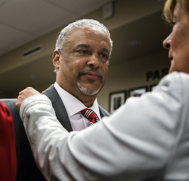 New UNLV men's basketball coach Marvin Menzies,left, and Tina Murphy-Kunzel talk before the University of Nevada Board of Regents approved his contract on Friday, April 22, 2016. Jeff Scheid/Las V ...