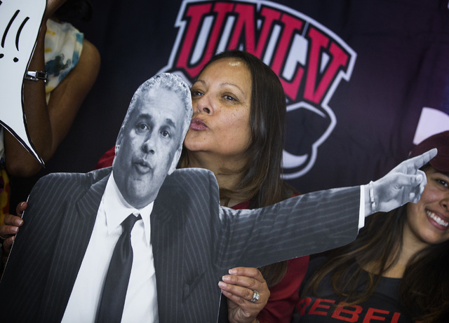 Tammy Menzies kisses a cardboard cutout of her husband and new UNLV men's basketball coach Marvin Menzies during a press conference at Mendenhall Center on Friday, April 22, 2016. Jeff Scheid/Las  ...
