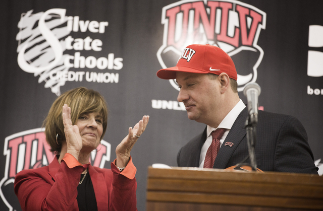 UNLV Director of Athletics Tina Kunzer-Murphy, left, applauds after introducing new UNLV basketball coach Chris Beard during a press conference at Mendenhall Center in Las Vegas on Friday, April 8 ...