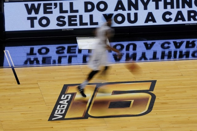 Old Dominion guard Ahmad Caver dribbles the ball across the Vegas 16 logo in the first half of the Vegas 16 championship game against Oakland at Mandalay Bay Events Center in Las Vegas Wednesday,  ...