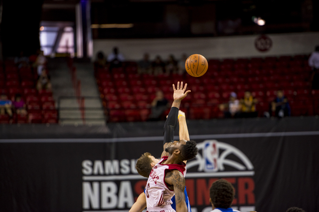 Ognjen Kuzmic (1) of the Golden State Warriors and Rakeem Christmas (28) of the Cleveland Cavaliers go up for the tip during the NBA Summer League at the Thomas & Mack Center in Las Vegas on F ...