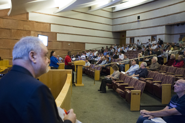 People participate in a Bureau of Land Management land auction at the Clark County Commission chambers on Tuesday, April 26, 2016, in Las Vegas. Erik Verduzco/Las Vegas Review-Journal Follow @Erik ...