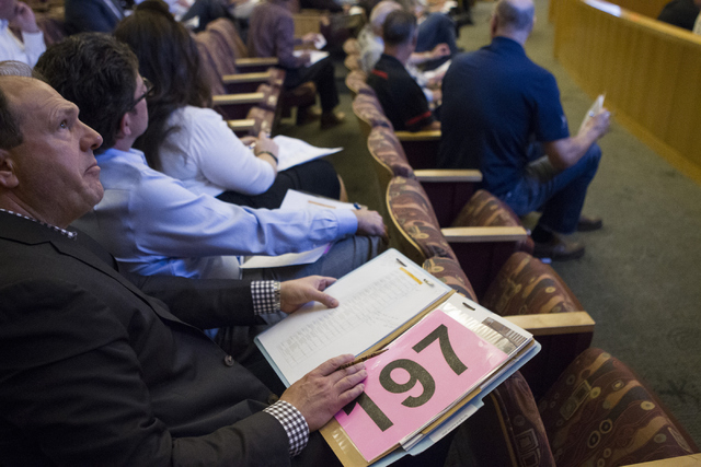 Joseph Kennedy, president of J. A. Kennedy Real Estate company, sits in a Bureau of Land Management land auction at the Clark County Commission chambers on Tuesday, April 26, 2016, in Las Vegas. E ...