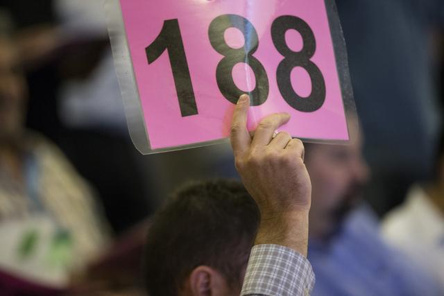 A man places a bid in a Bureau of Land Management land auction at the Clark County Commission chambers on Tuesday, April 26, 2016, in Las Vegas. Erik Verduzco/Las Vegas Review-Journal Follow @Erik ...
