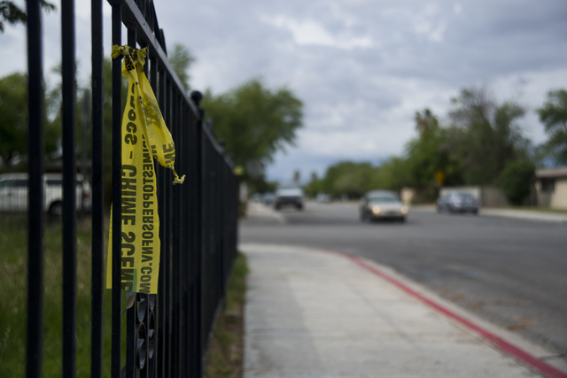 Crime scene tape remains at the scene where a body was discovered early Saturday near Sunrise Avenue and Prince Lane in Las Vegas on Saturday, April 30, 2016. (Daniel Clark/Las Vegas Review-Journa ...