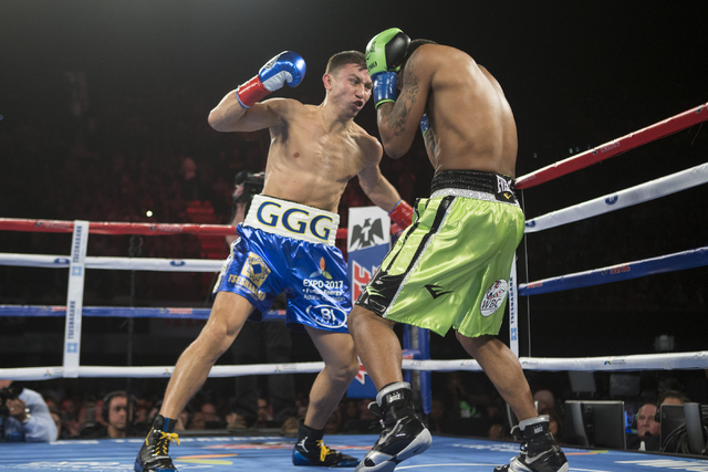 Gennady Golovkin, left, battles Dominic Wade in the Middleweight World Championship bout at The Forum on Saturday, April 23, 2016, in Inglewood, Calif. Golovkin won by way of knockout in the secon ...