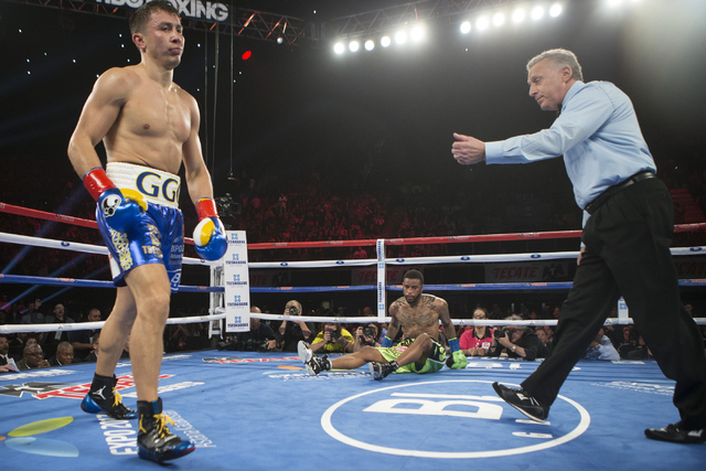 Gennady Golovkin, left, knocks down Dominic Wade in the second round of the Middleweight World Championship bout at The Forum on Saturday, April 23, 2016, in Inglewood, Calif. Golovkin won by way  ...