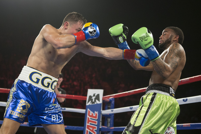Gennady Golovkin, left, throws a left punch against Dominic Wade in the Middleweight World Championship bout at The Forum on Saturday, April 23, 2016, in Inglewood, Calif. Golovkin won by way of k ...