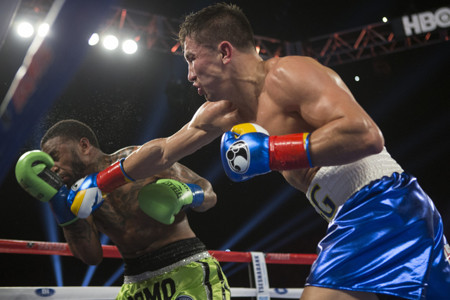 Gennady Golovkin, right, connects a right punch to knock out Dominic Wade in the second round of the Middleweight World Championship bout at The Forum on Saturday, April 23, 2016, in Inglewood, Ca ...