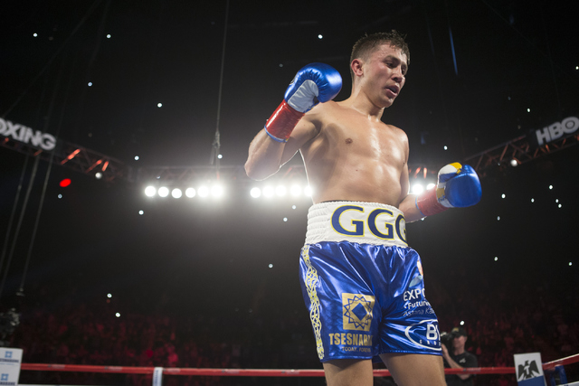 Gennady Golovkin walks to a corner after knocking down Dominic Wade in the second round of the Middleweight World Championship bout at The Forum on Saturday, April 23, 2016, in Inglewood, Calif. G ...