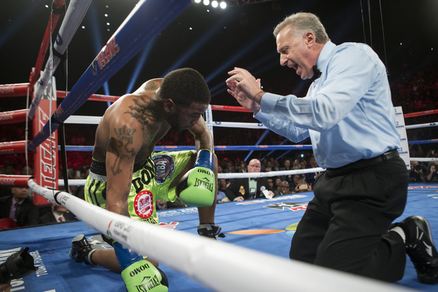 Dominic Wade gets a count after getting knocked out by Gennady Golovkin in the second round of the Middleweight World Championship bout at The Forum on Saturday, April 23, 2016, in Inglewood, Cali ...