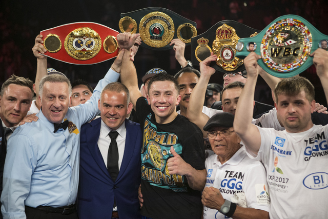 Gennady Golovkin poses after his knockout win in the second round against against Dominic Wade in the Middleweight World Championship bout at The Forum on Saturday, April 23, 2016, in Inglewood, C ...