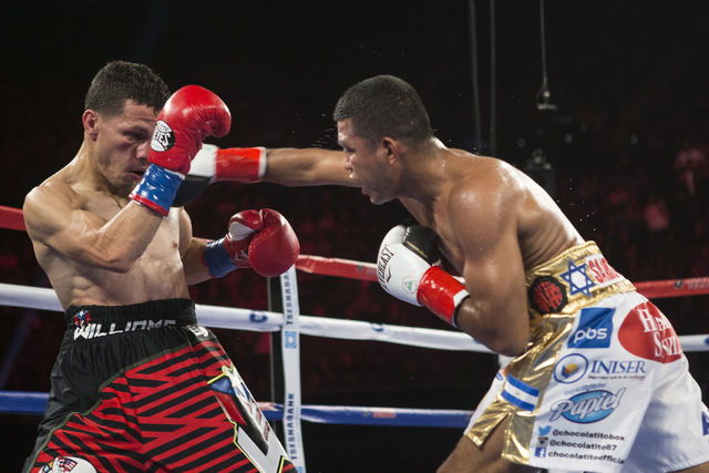 Roman Gonzalez, right, throws a right punch against McWilliams Arroyo in the Middleweight World Championship bout at The Forum on Saturday, April 23, 2016, in Inglewood, Calif. Gonzalez won by una ...