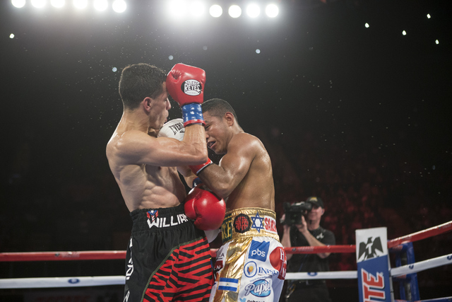 Roman Gonzalez, right, lands a left punch against McWilliams Arroyo in the Middleweight World Championship bout at The Forum on Saturday, April 23, 2016, in Inglewood, Calif. Gonzalez won by unani ...