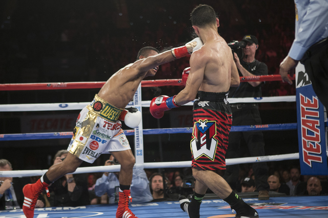 Roman Gonzalez, left, connects a right punch against McWilliams Arroyo in the Middleweight World Championship bout at The Forum on Saturday, April 23, 2016, in Inglewood, Calif. Gonzalez won by un ...