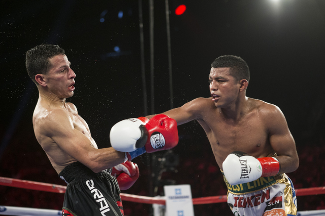 McWilliams Arroyo, left, moves away from a punch by Roman Gonzalez in the Middleweight World Championship bout at The Forum on Saturday, April 23, 2016, in Inglewood, Calif. Gonzalez won by unanim ...