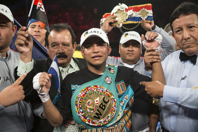 Roman Gonzalez poses after his unanimous decision victory against McWilliams Arroyo in the Middleweight World Championship bout at The Forum on Saturday, April 23, 2016, in Inglewood, Calif. Erik  ...