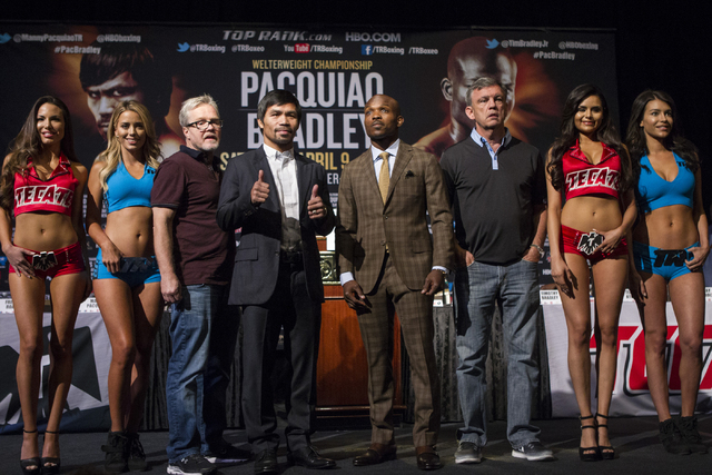From left, Freddie Roach, Manny Pacquiao, Timothy Bradley Jr. and Teddy Atlas pose during the final news conference before the fight between Pacquiao and Bradley at the MGM Grand casino-hotel on W ...
