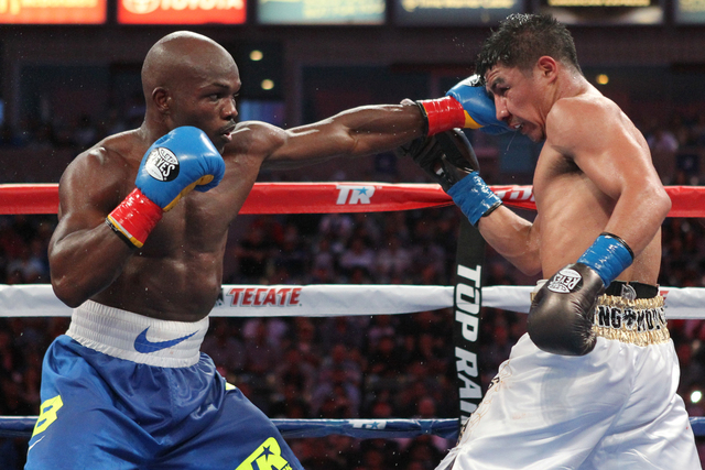 Timothy Bradley Jr., left, connects a left punch against Jessie Vargas during their fight at StubHub Center in Carson, Calif., in 2015. Bradley Jr. won by unanimous decision. (Erik Verduzco/Las Ve ...