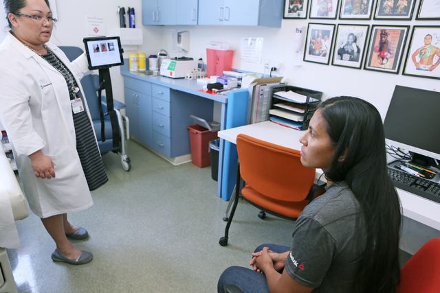 Research coordinator Pamela Dino, left, administers a visual test with MMA fighter Lynn Alvarez, 30, using a C3 iPad app at Cleveland Clinic Lou Ruvo Center for Brain Health Thursday, April 28, 20 ...