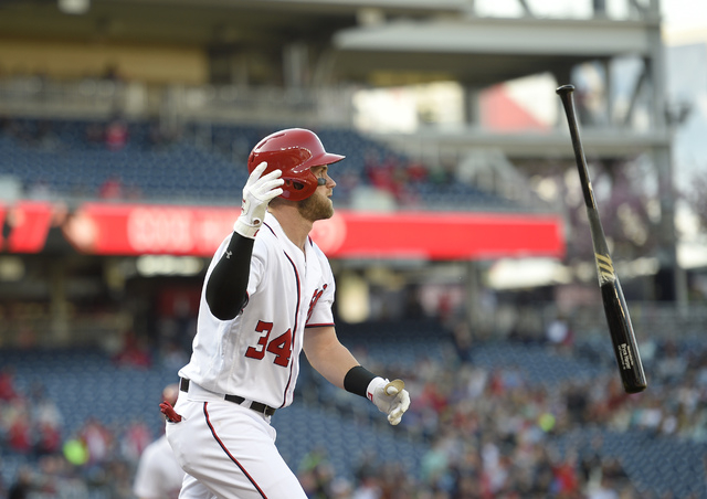 Washington Nationals' Bryce Harper watches his grand slam during the third inning of an baseball game against the Atlanta Braves, Thursday, April 14, 2016, in Washington. This was Harpers' 100th h ...