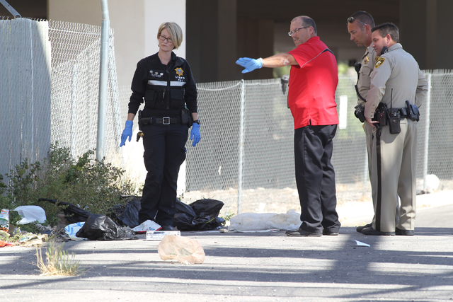 Police search for evidence at the scene of a shooting on 13th Street near Stewart Avenue on Saturday, April 16, 2016, in Las Vegas. One person was injured and one person is in custody. Brett Le Bl ...