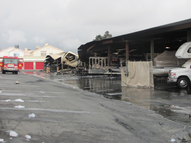 An Investigator Works At The Scene Of A Fire At The Storage At Summerlin  Business On