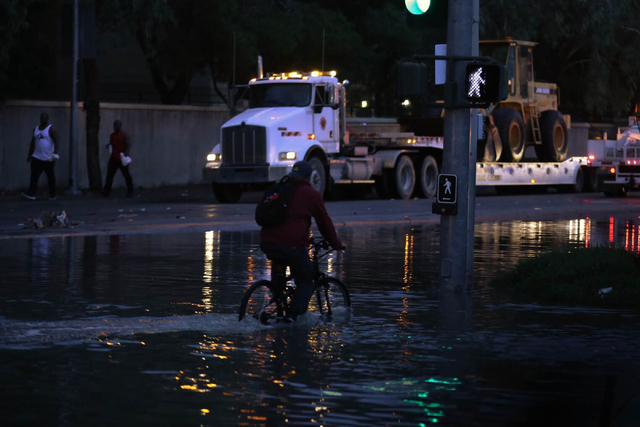 A man rides his bicycle though the intersection of Koval Lane and Winnick Avenue near the Linq in Las Vegas on Saturday, April 9, 2016. Brett Le Blanc/Las Vegas Review-Journal Follow @bleblancphoto