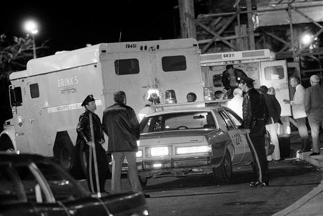 In this Oct. 21, 1981, file photo, police are at the scene of a Brinks armored truck robbery at the Nanuet Mall in Nanuet, N.Y., where multiple Nyack police officers and a Brinks guard were killed ...
