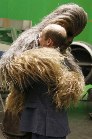 Britain's Prince William, gets a hug from the Star Wars character Chewbacca during a tour of the Star Wars sets at Pinewood studios. (AP/Adrian Dennis)