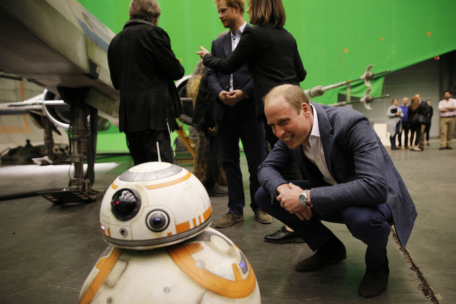 Britain's Prince William looks at BB-8 droid during a tour of the Star Wars sets at Pinewood studios. (AP/Adrian Dennis)