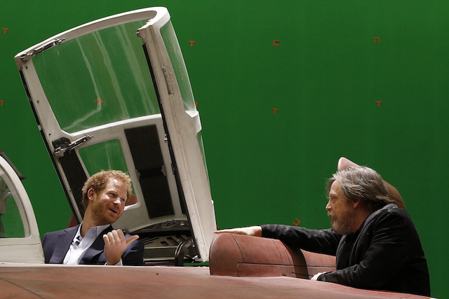 Britain's Prince Harry sits in an A-wing fighter as he talks with US actor Mark Hamill during a tour of the Star Wars sets at Pinewood studios. (AP/Adrian Dennis)