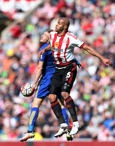 Leicester City's Jamie Vardy, left, vies for the ball with Sunderland's Younes Kaboul during the English Premier League soccer match between Sunderland and Leicester City at the Stadium of Light,  ...
