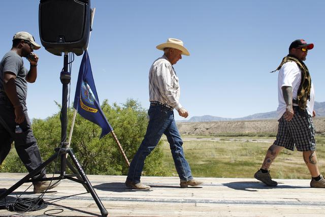 Rancher Cliven Bundy, center, walks on stage to speak at a press conference near Bunkerville, Nev. Thursday, April 24, 2014. (John Locher/Las Vegas Review-Journal)
