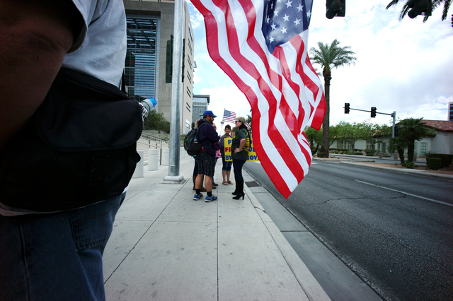 People protest outside of the Lloyd George Federal Building ahead of an arraignment for Ammon and Ryan Bundy, among others, in Las Vegas on Friday, April 15, 2016. (Chase Stevens/Las Vegas Review- ...