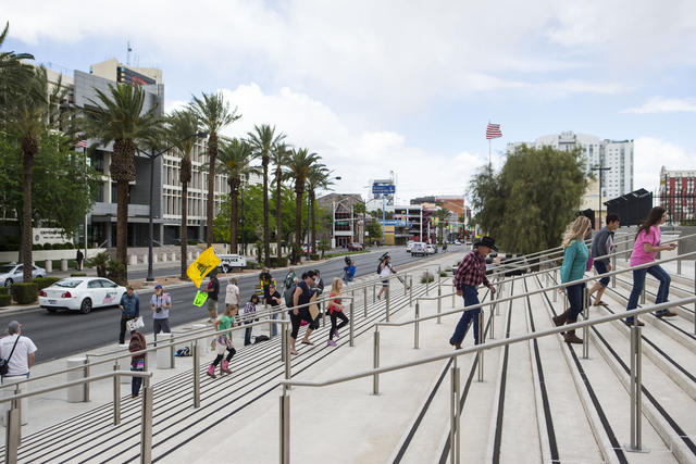 People walk towards Lloyd George Federal Building ahead of an arraignment for Ammon and Ryan Bundy, among others, in Las Vegas on Friday, April 15, 2016. (Chase Stevens/Las Vegas Review-Journal) F ...