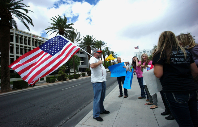 People, including Doug Knowles of Pahrump, left, protest outside of the Lloyd George Federal Building ahead of an arraignment for Ammon and Ryan Bundy, among others, in Las Vegas on Friday, April  ...